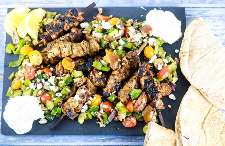 Chicken Souvlaki with fresh Greek Salad-on the board with pita-feature