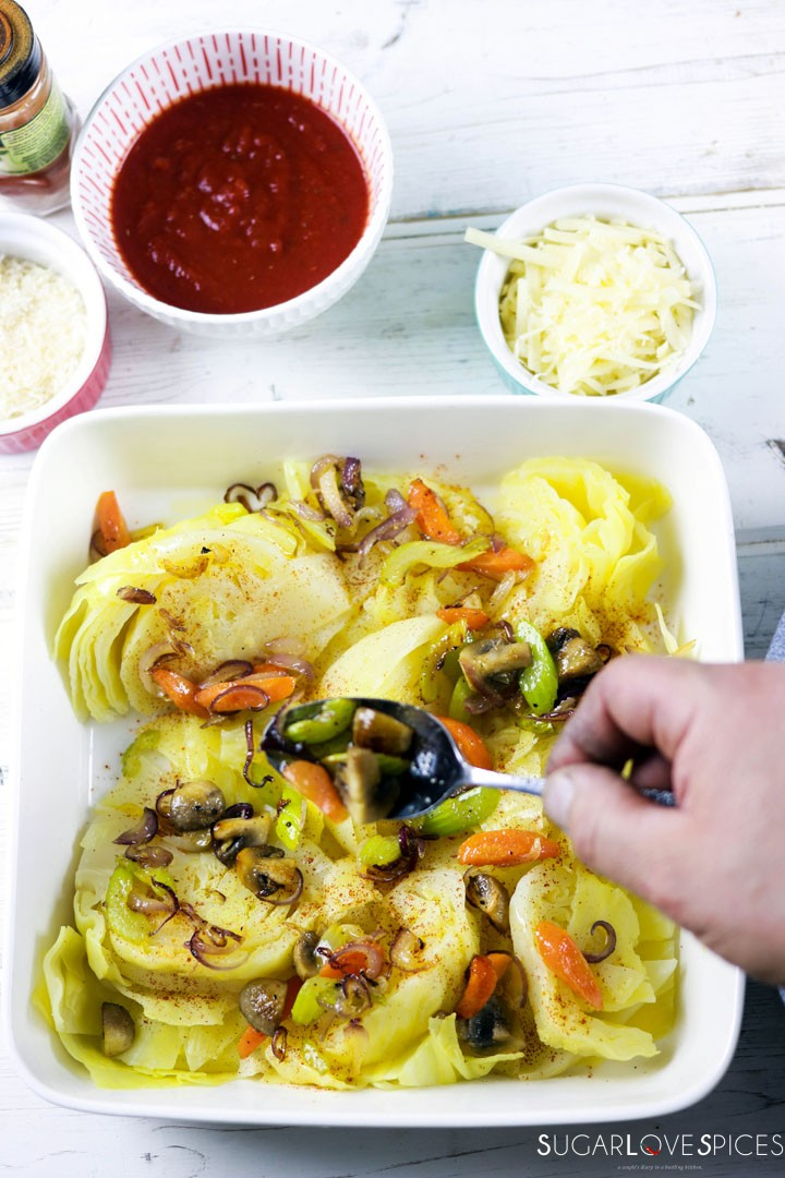 Oven Roasted Cheesy Cabbage-prep-topping cabbage with vegetables