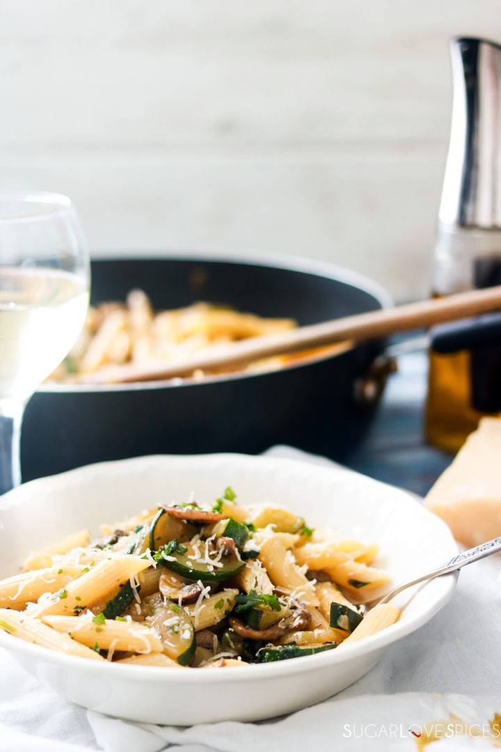 Penne with Zucchini and Mushrooms-plate and pan in background