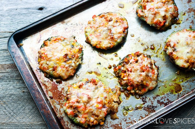 PORTOBELLINI CHEESE MELTS WITH PESTO AND PEPPERS-in the pan, partial