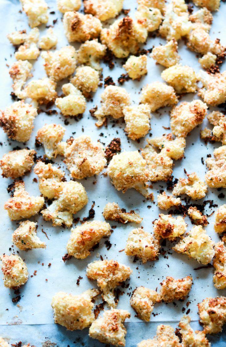 panko and asiago crusted popcorn cauliflower-baked-on baking sheet-vertical