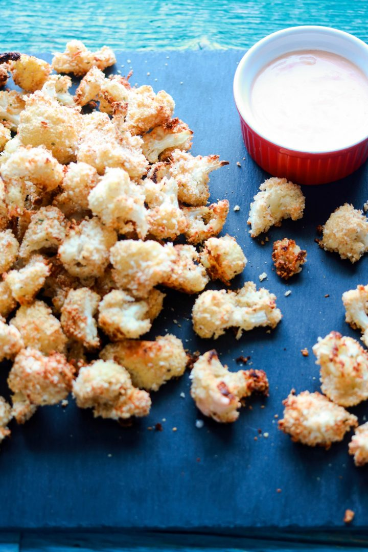 panko and asiago crusted popcorn cauliflower-on a board-sauce on the side