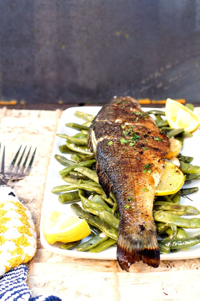 Grilled branzino stuffed with lemon and herbs for Branzino fish recipes