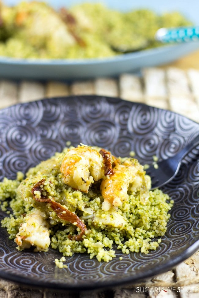 Scampi with artichokes over pesto cous cous