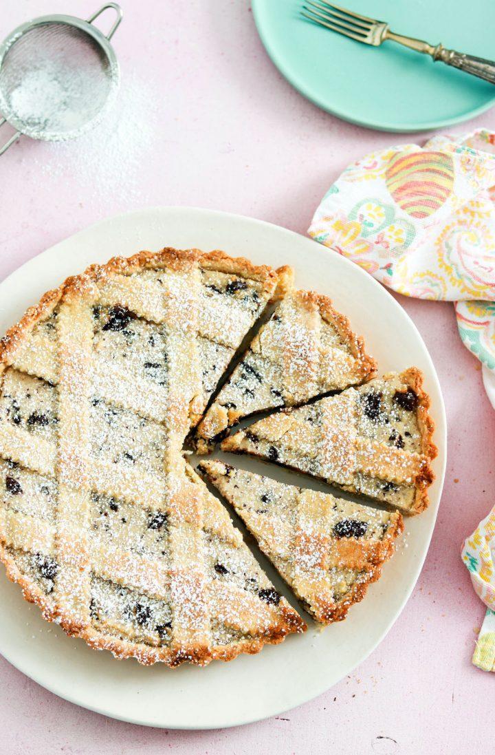 Classic Italian Crostata ricotta e cioccolato-sliced in a white plate