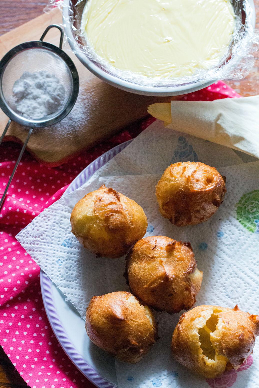 bigne di san giuseppe-prep-fried puffs on a plate