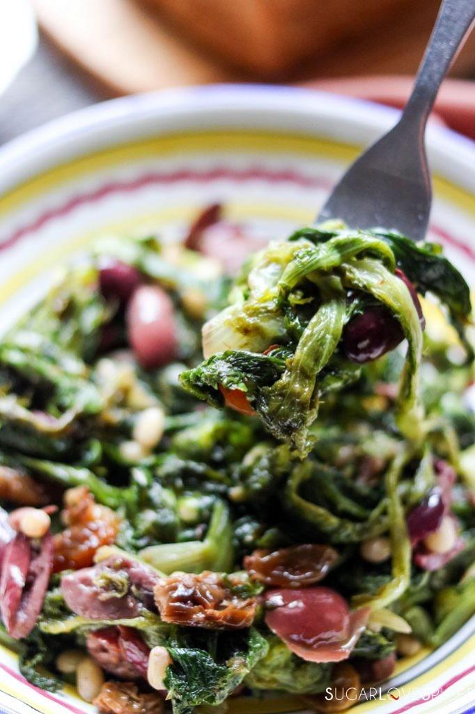 Scarola alla Napoletana-Sauteed Escarole with Olives, raisins, and Pine Nuts
