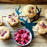 coconut raspberry spelt muffins-muffins and raspberries on a tray