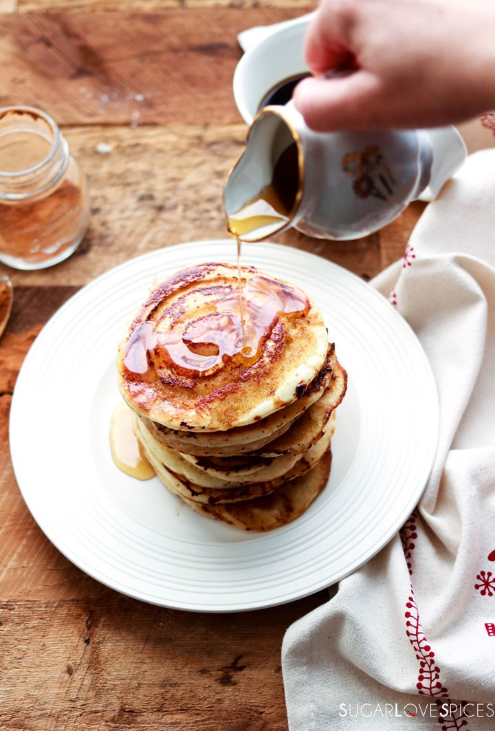 Cinnamon Swirl Pancakes-pouring maple syrup