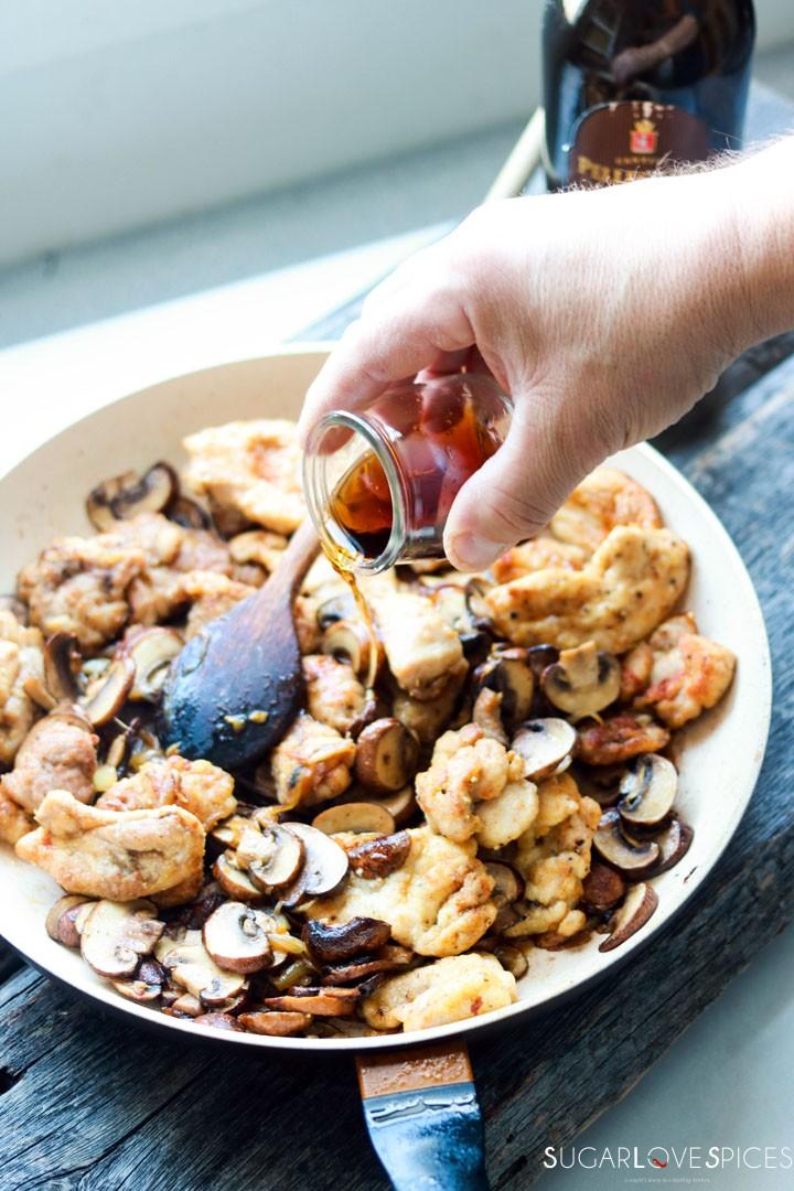 Creamy Chicken and Mushroom Marsala-pouring marsala