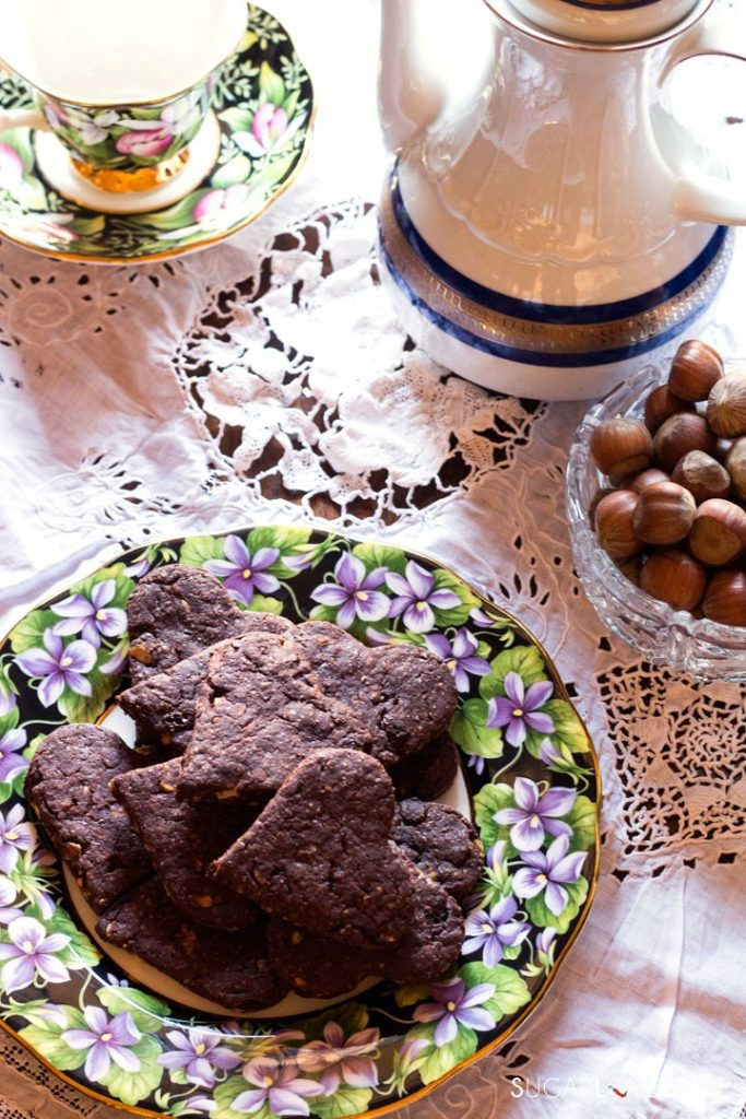 Olive oil spelt flour cookies with chocolate and hazelnuts-plate cup and teapot