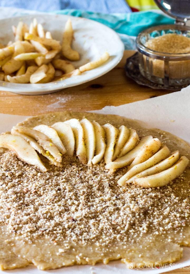 Rustic Pear & Hazelnut Vegan Galette-arranging pears