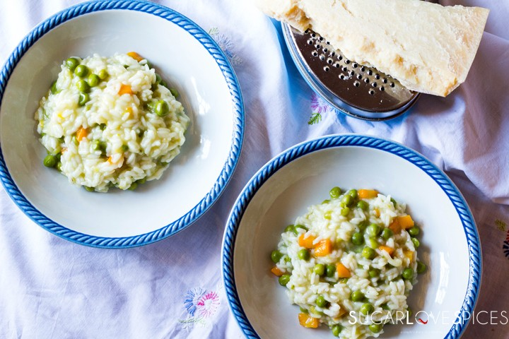 Rice with peas and carrots-two plates and parmigiano