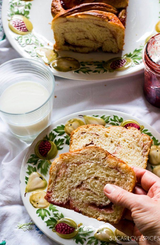 Strawberry jam brioche bread-slice with milk