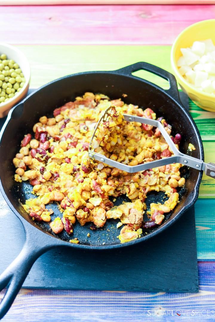 Bean medley Pakora Inspired Tacos-mashing beans