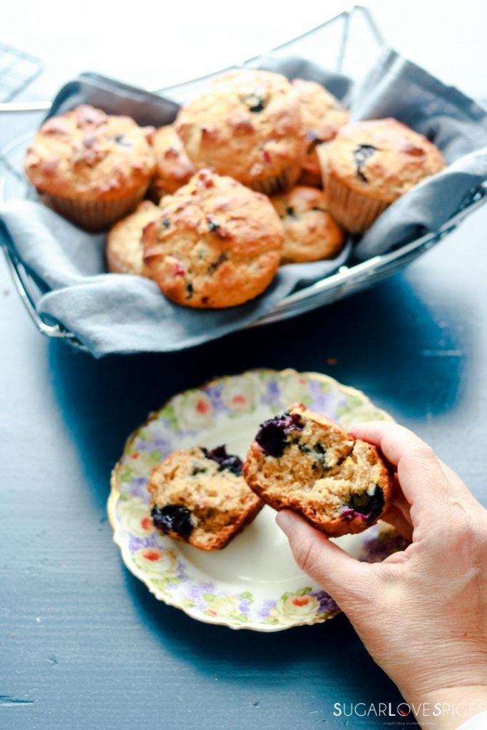 Blueberry Rhubarb Yogurt Muffins with Spelt Flour-hand