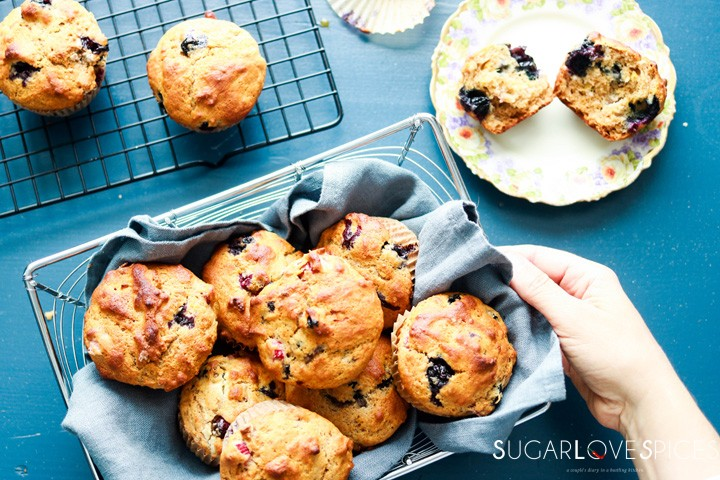 Blueberry Rhubarb Yogurt Muffins with Spelt Flour-in the basket-hand