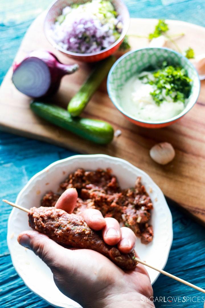 Grilled Beef Kafta with Tzatziki sauce-forming kafta