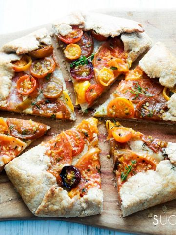 heirloom tomato galette-cut on a board-feature