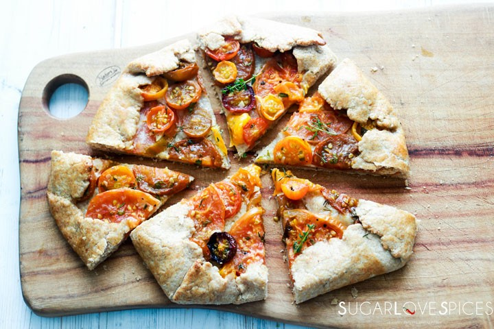 heirloom tomato galette-cut on a board-horizontal
