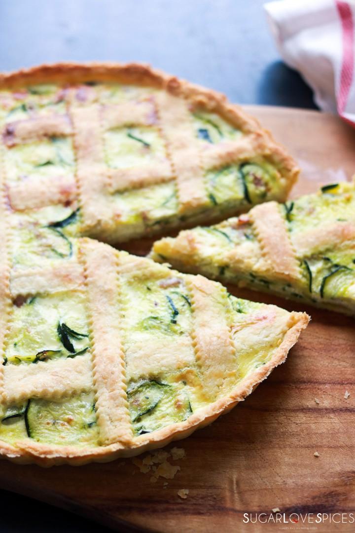 Savory Crostata with zucchini and prosciutto-on board-slice-closeup