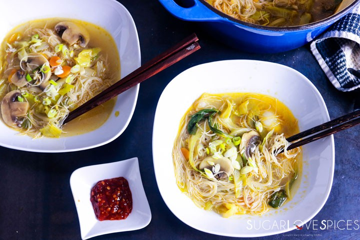 Asian inspired brown rice vermicelli noodle soup-two bowls of soup with pot in background