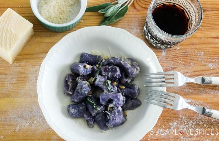 Homemade purple potato gnocchi-plate of cooked gnocchi