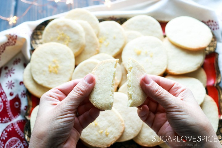Slice and bake lemon crips-hands breaking a cookie