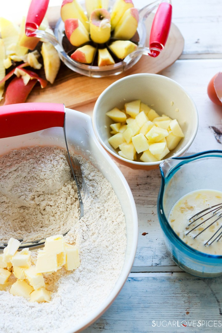 Spiced Apple Eggnog Scones-adding cubed butter to bowl with dry ingredients