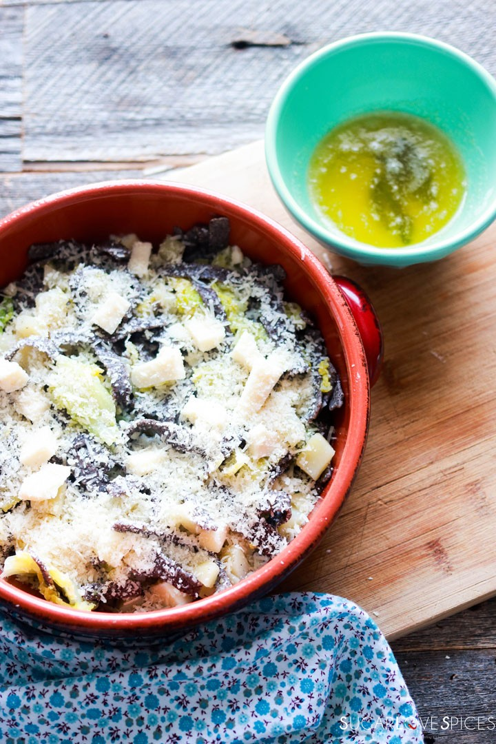 Buckwheat Pasta with Cabbage and Potatoes (Pizzoccheri)-prep-topping with cheese-butter and sage in a bowl on the side