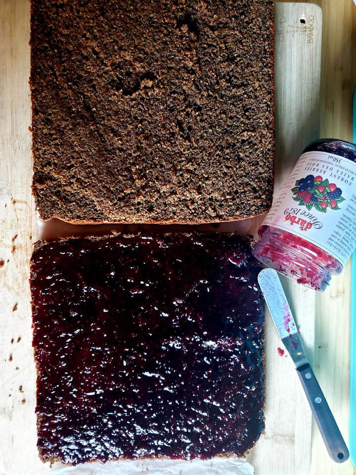 Buckwheat and Jam Cake-spreading jam on one half