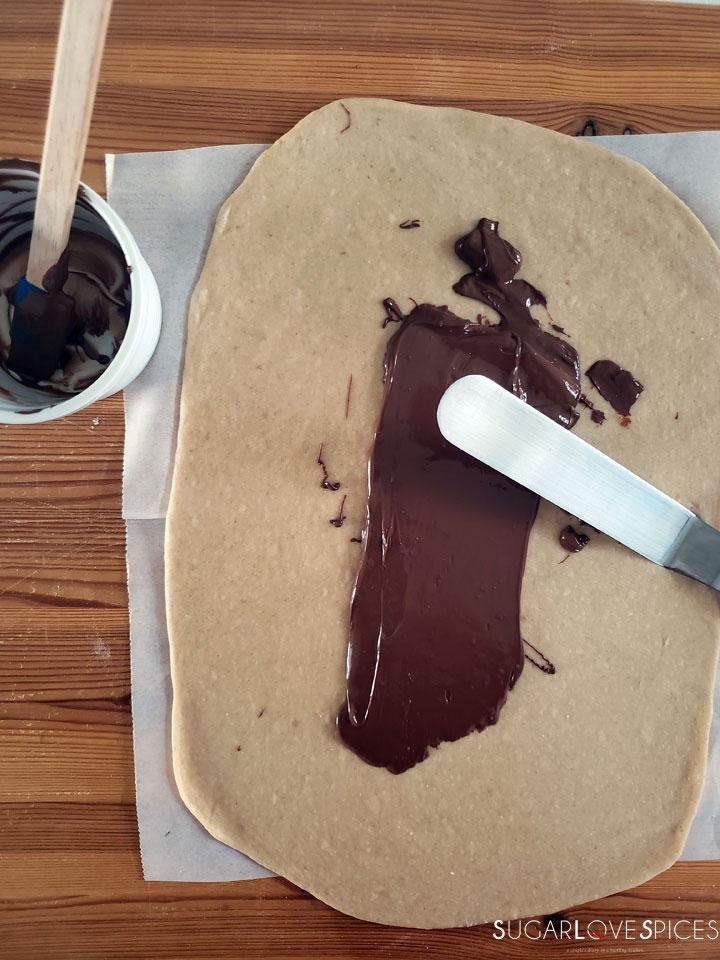Nutella Pain Brioche Braid-spreading nutella on the dough