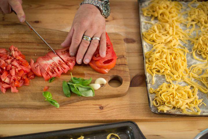 cutting tomato on a board