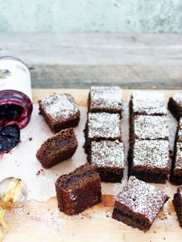 Buckwheat and Jam Cake-squares on a board with jam and spoon-feature