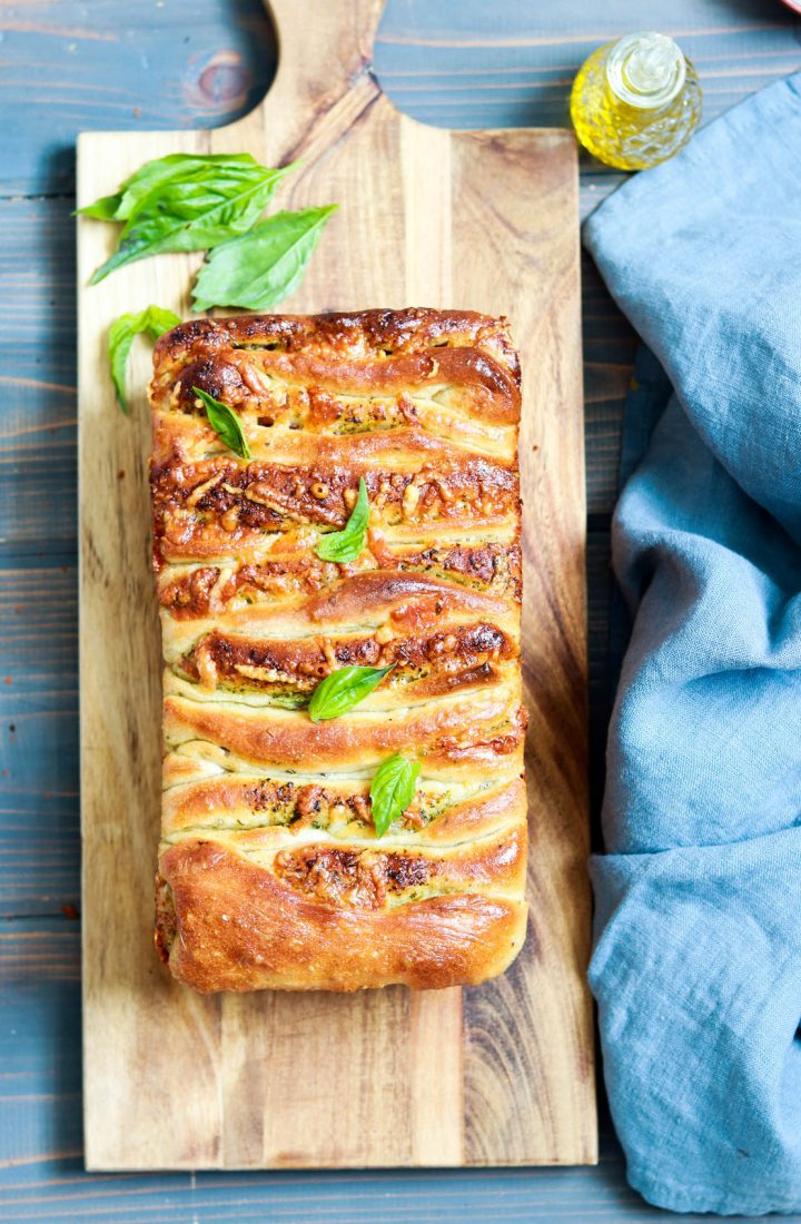 Pesto and Salami Pull-Apart Bread-bread on woodboard-oil on the side