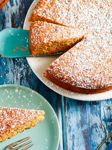 Simple Carrot Almond Cake with Kamut Flour-feature-slice in a plate-cake on the side