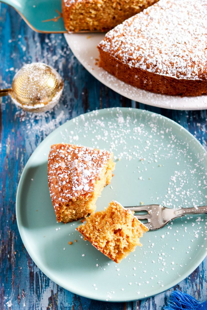Simple Carrot Almond Cake with Kamut Flour-half slice in the plate-fork in