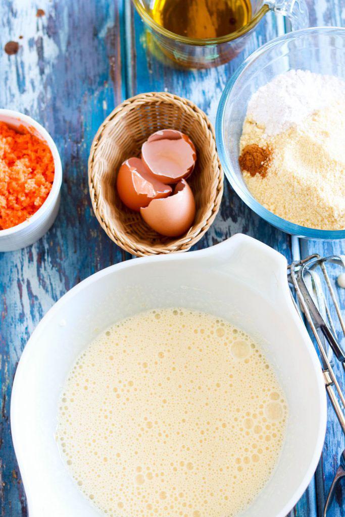 Simple-Carrot-Almond-Cake-with-Kamut-Flour-prep-beaten-egg-mixture-iin-a-bowl