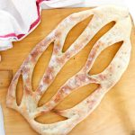 Fougasse, traditional Bread from Provence-bread on pizza paddle-closeup