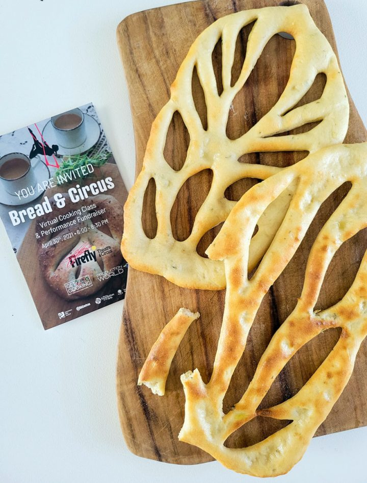 Fougasse, traditional Bread from Provence-bread on wood board with flyer