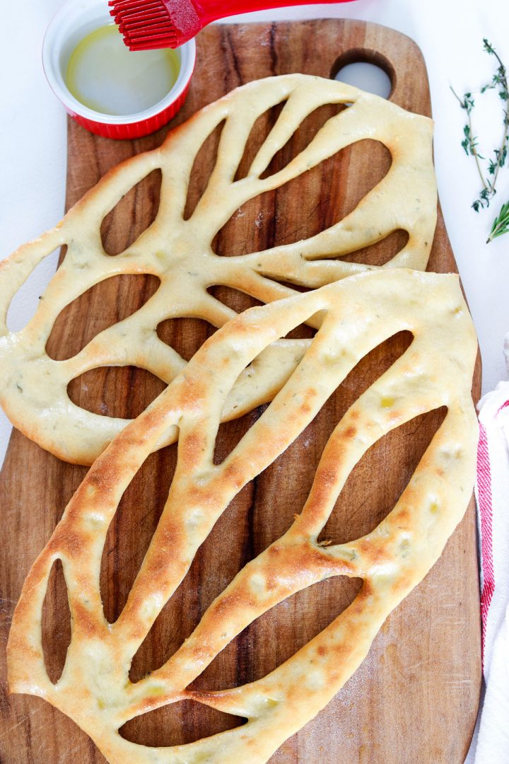 Fougasse, traditional Bread from Provence-breads on wood board-oil in background