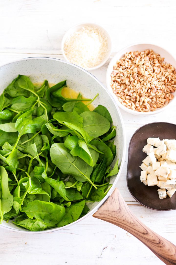 Quick 30-minute Spaghetti with Spinach Gorgonzola and Walnuts-wilting spinach in the pan