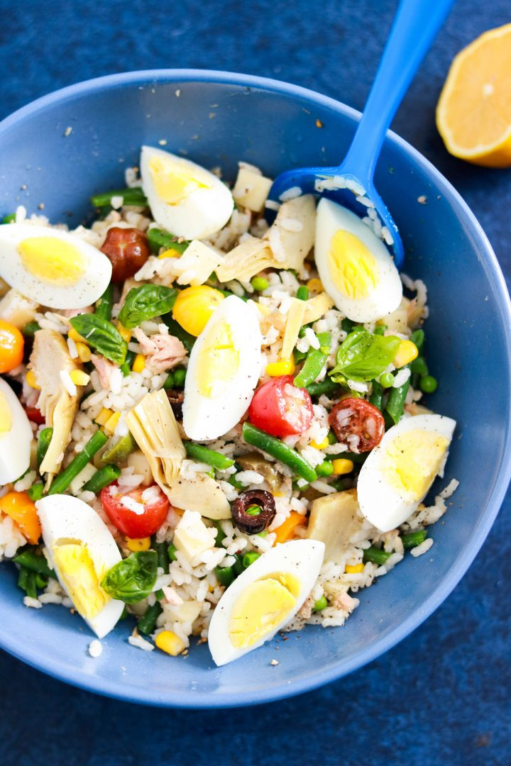 Tasty and Easy Italian Insalata di riso with tuna-rice mixed with all ingredients