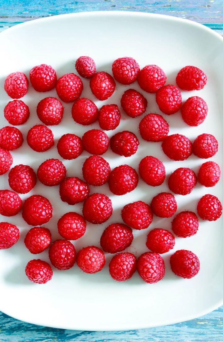 Crostatine crema e lamponi-close up of raspberries on a plate