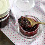 Small batch no-pectin Saskatoon jam-feature-jam on spoon and jam jar