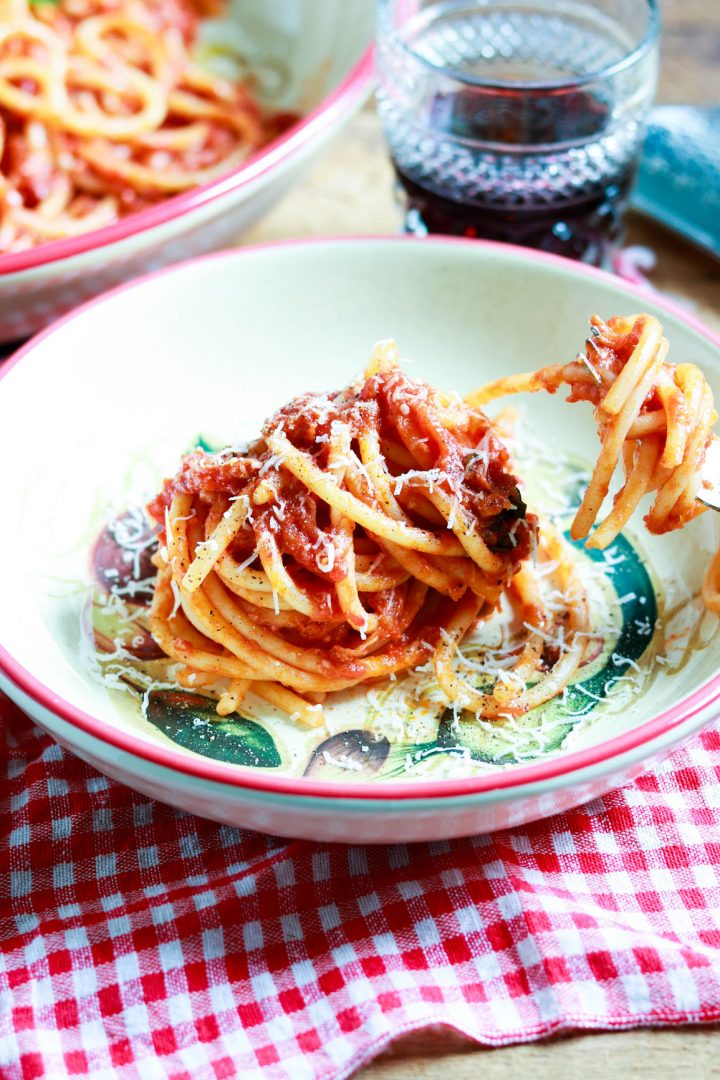 Bucatini-al Pomodoro with tuna and capers-plated-closeup-fork in