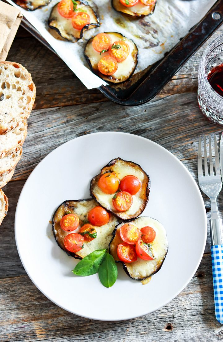 Eggplant-bruschetta-bites-on-the-plate-top-view-fork-wine
